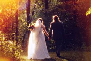 Bride and groom walking in woods on vintage Super 8 film