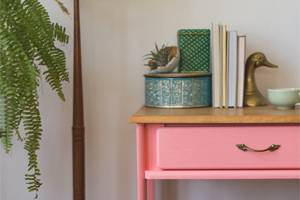 Close up of painted pink desk drawer